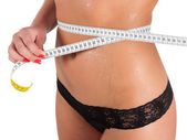 Woman measuring perfect shape of beautiful thigh healthy. — Stock Photo