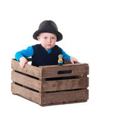 Little boy with hat in wooden box — Stock Photo