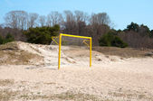 Football gate on a sand beach — 图库照片