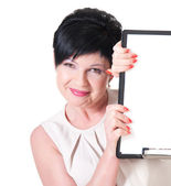 Smiling business woman with blank — Stock Photo
