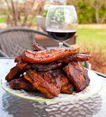 Grill meat on a plate with glass of wine. — Stock Photo