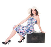 Beautiful woman in summer dress with hat and case — Stock Photo