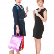 Two smiling womenwith shopping bags holding money — Stock Photo