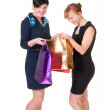 Stock Photo: Portrait of elegant two women with shopping bags