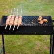 Stock Photo: Bbq ribs and bacon on grill with charcoal