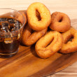 Oil donuts and colwith ice on wooden plate — Photo #27357535
