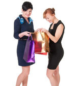 Portrait of elegant two women with shopping bags — Stock Photo