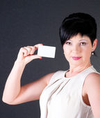 Serious business woman with blank card — Stock Photo