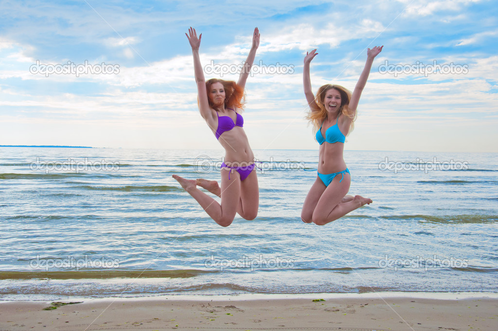 photo of girls sitting in water at beach № 16911