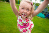 Portrait of a smiling Little girl in garden — Stock Photo