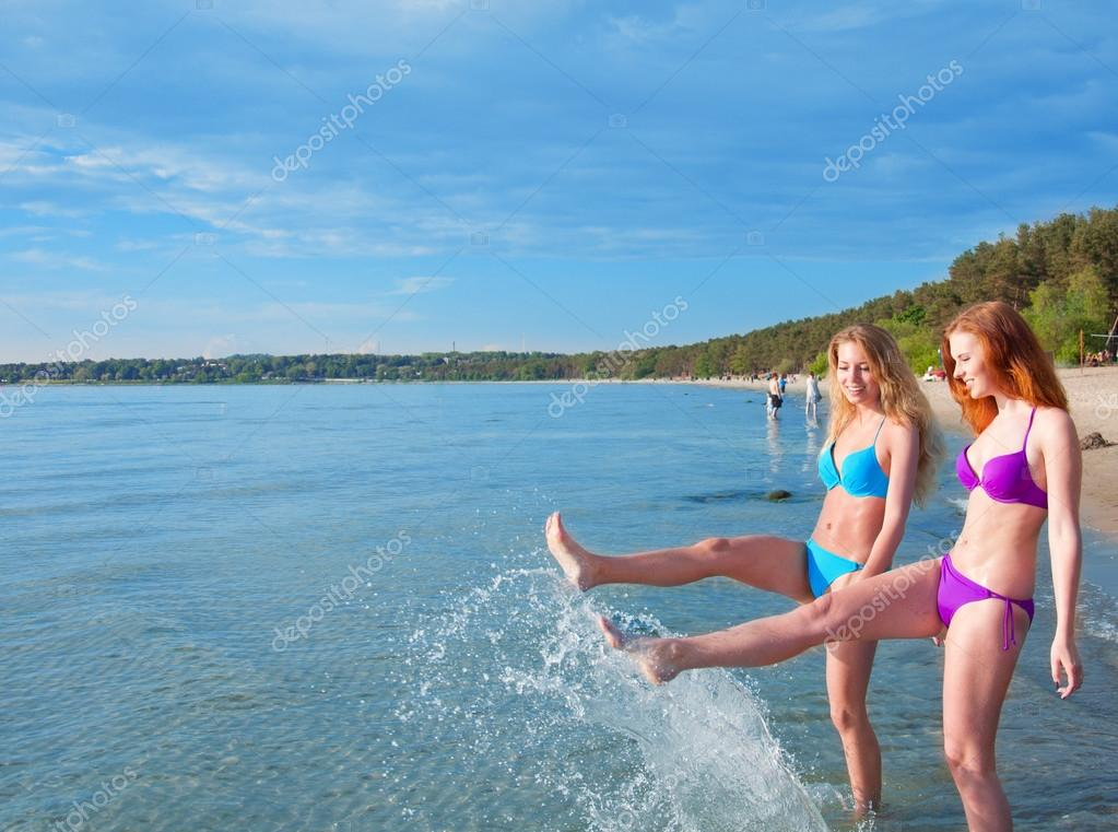 photo of girls sitting in water at beach № 16887