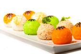 New sushi balls with flowers of nori — Stock Photo