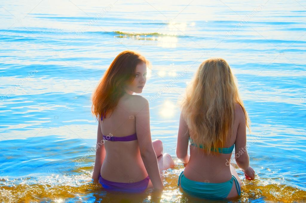 photo of girls sitting in water at beach № 16849