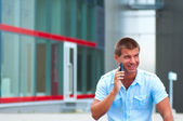 Business man with mobile phone outdoor — Stock Photo