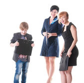 Two handsome women and their boss holding folder with papers. — Stock Photo