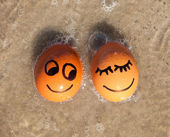 Easter funny eggs on a beach — Stock Photo