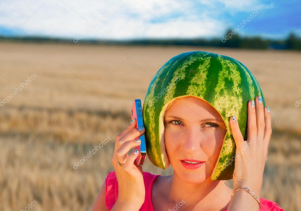 Woman with water-melon as helmet | Stock Photo | Colourbox
