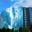 Modern office glass building over blue sky — Stock Photo #30162789