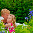 Happy father and little girl at a garden — Stock Photo #30860341