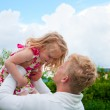 Happy father and little girl at a garden — Stock Photo #30860999