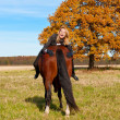 Beautiful woman walking with horse  — Stok fotoğraf