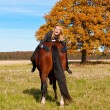 Beautiful woman walking with horse  — Foto de Stock