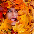 Beauty portrait of beautiful female face with autumn leaves — Stock Photo #33685877