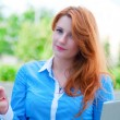 Stock Photo: Pretty young business womusing mobile phone