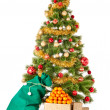 Stock Photo: Christmas tree with gifts and mandarines