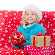 Funny little girl around christmas boxes — Stock Photo