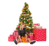 Beautiful woman in sitting with mandarines and present or gift boxes — Stock Photo