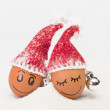 Funny lovely  eggs in winter santa hats — Stock Photo