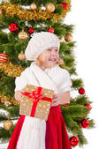 The portrait of the little child smiling and holding present box — Stock fotografie