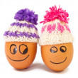 Stock Photo: Funny lovely eggs in winter hats