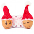 Funny lovely  eggs in winter santa hat — Stock Photo
