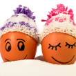 Funny lovely eggs in winter hats and sugar like snow — Stock Photo #35043401