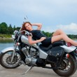 Beautiful, sexy, young woman on a motorcycle — Stock Photo