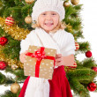 The portrait of the little child smiling and holding present box — Stock Photo