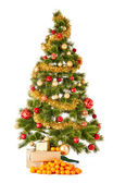 Christmas tree with gifts and presents and mandarines — Stock Photo