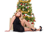 Beautiful blond smiling woman and the Christmas tree — Stock Photo