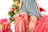 Woman sexy legs and red bow — Stock Photo