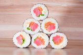 Maki Sushi on wooden background — Stock Photo