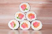 Maki Sushi on wooden background — Stock Photo