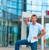 Business man holding a key — Stock Photo