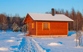 Wooden saun house in snow and frozen landscape — Stock Photo