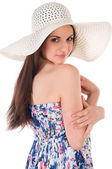 Woman in summer dress with hat — Stock Photo