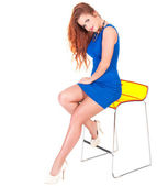 L woman with red hairs sitting on bar chair — Stok fotoğraf