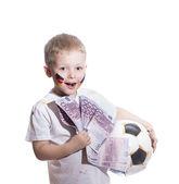 Pojke med fotboll boll och euron pengar — Stockfoto