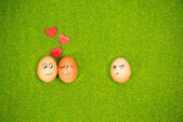 Funny eggs in love and one jealous egg — Stock Photo