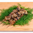 Grill meat on a sticks with green on wooden plate — Stock Photo #48227255